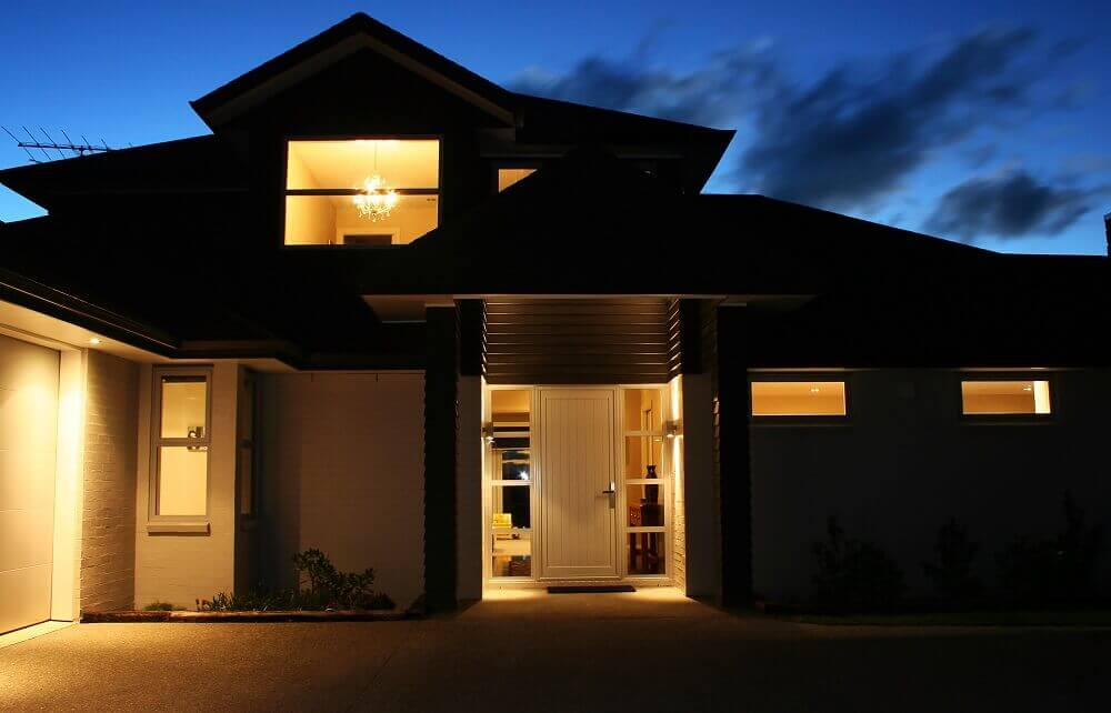 Secure two storey house at night