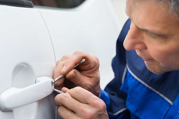 Locksmith opening locked car door